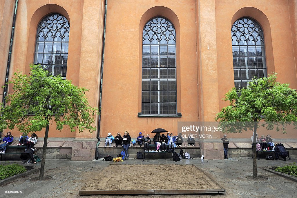 Schoolchildren enjoy a picnic outside of the Cathedral, known as Storkyrkan, situated near the Royal Castle in Stockholm on May 25, 2010, less than a month before Crown Princess Victoria 's wedding, the 32-year-old eldest daughter of King Carl XVI Gustaf. Tensions with the archbishop, the future prince's health problems and the soaring cost of the festivities are just some of the controversies surrounding the run-up to Swedish Crown Princess Victoria and her husband-to-be Daniel Westling's June 19 wedding.