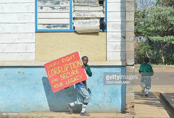 Schoolchildren from the Lang'ata road primary flee tear gas on January 19 2015 in Nairobi after breaking a wall illegally erected around it and being...