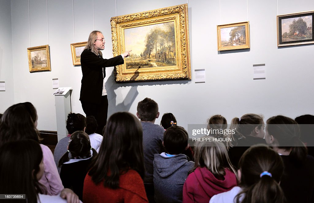 LAOUCHEZ Schoolchildren listens on October 7, 2013 to the explanations of an employee of the La Chartreuse museum in Douai, northern France, during their visit of the exhibition 'Corot in the light of the North' dedicated to French painter Camille Corot. The event is held from October 5, 2013 to January 6, 2014.