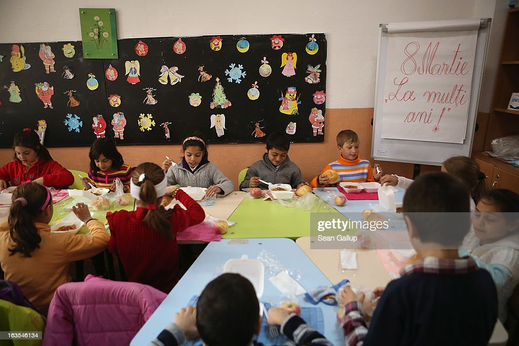 Schoolchildren, most of them ethnic Roma, have a hot lunch before afternoon activities that will include assisted homework in an after-school program sponsored by the European Commission on March 11, 2013 in Dilga, Romania. The program, called the Roma Education Fund, is aimed at bridging the educational gap between Roma and non-Roma across Europe, and in Romania the problem is particularly acute. Dilga is a settlement of 2,500 people with dirt roads and no running water, and unemployment is at 70%. Most of the working-age men and women have at some point worked abroad, mostly in Italy or Great Britain, as many say they are unable to find adequate work in Romania. Romania's Roma belong to a myriad of different tribes defined by their craft, and Dilga's belong to a group called the Rudari, who until the 1930s specialised in woodcrafts. During the communist years most worked in nearby state-run factories and agricultural cooperatives, though the majority of these went bankrupt after 1989 and the local Roma lost their jobs. Since then they have struggled to make ends meet and find a better future for their children, though projects initiated by the European Union and NGOs are helping some to launch small-scale enterprises and improve their children's education.