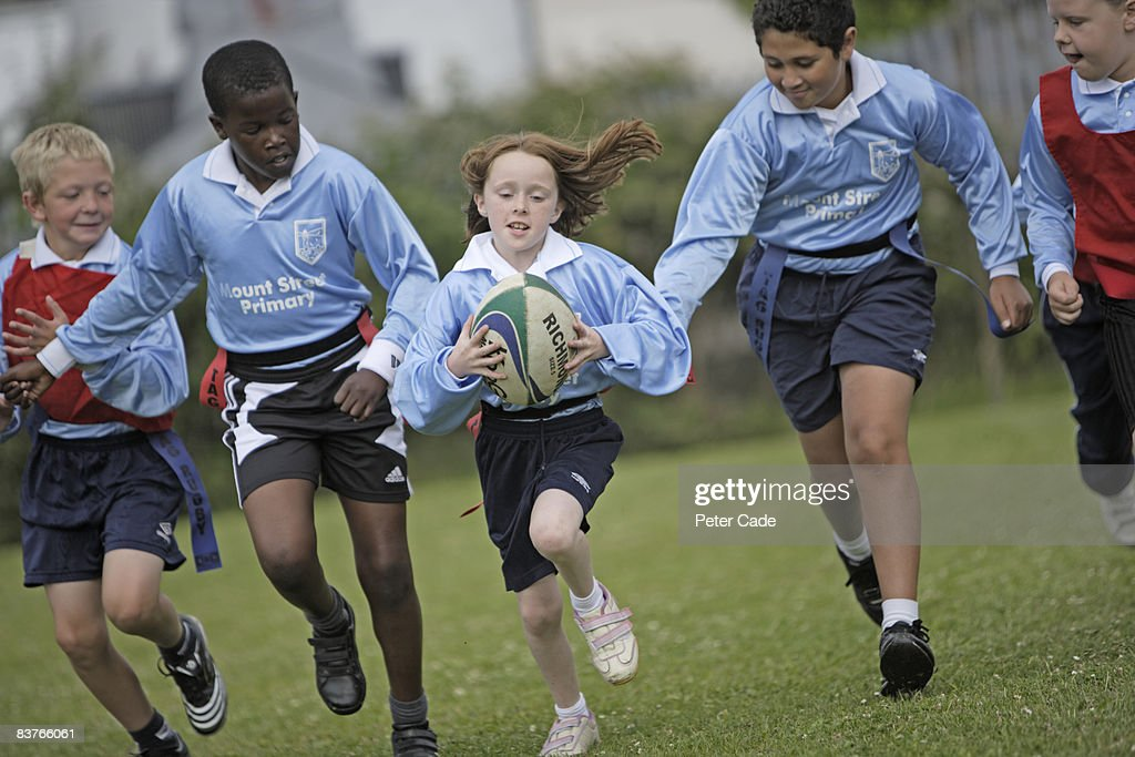 schoolchildren playing rugby : Stock Photo