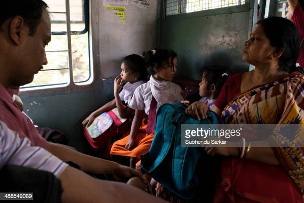 Schoolchildren return home from school in a local train Indian Railways is owned and operated by the government of India It is one of the world's...