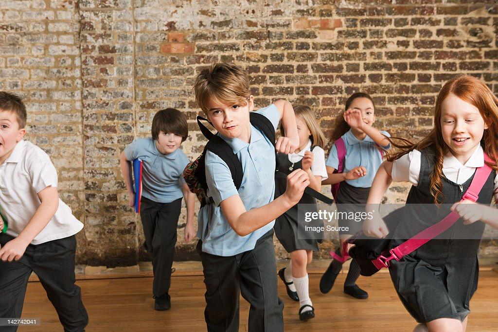 Schoolchildren running : Stock Photo
