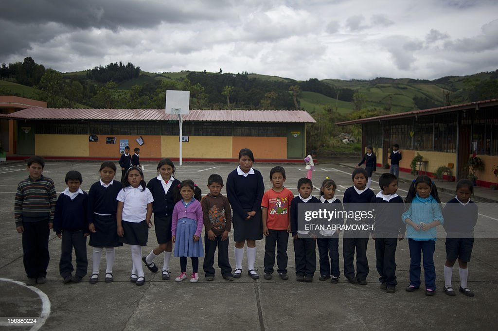 Schoolchildren, sons and daughters of Colombian refugees, poses at a rural school at Chitan de Navarrete, Carchi province, Ecuador, close to the border with Colombia, on November 7, 2012. AFP PHOTO/Eitan Abramovich