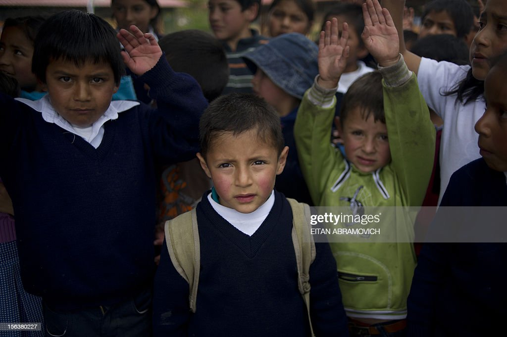 Schoolchildren, sons of Colombian refugees, poses at a rural school at Chitan de Navarrete, Carchi province, Ecuador, close to the border with Colombia, on November 7, 2012. AFP PHOTO/Eitan Abramovich