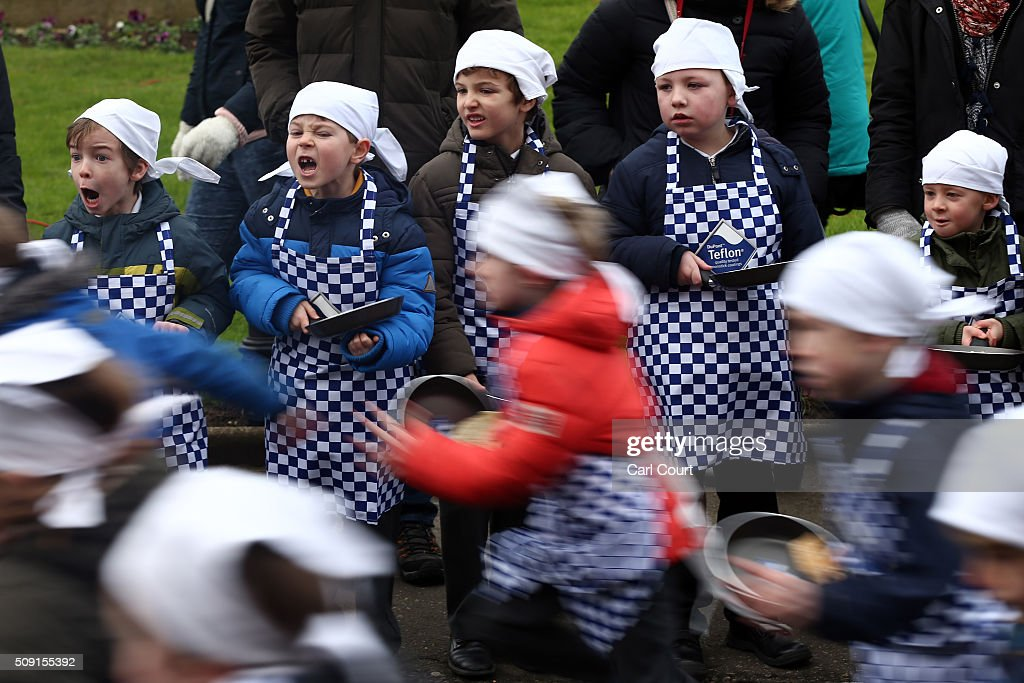 Schoolchildren take part in a pancake race ahead of the annual Shrove Tuesday ladies trans-Atlantic pancake race on February 9, 2016 in Olney, England. On Shrove Tuesday every year the ladies of Olney, Buckinghamshire compete in a Pancake Race, a tradition which dates back to 1445. Children from Olney schools also take part in their own races. Olney competes every year against the women of Liberal, Kansas, USA in a friendly race dating back to 1950.