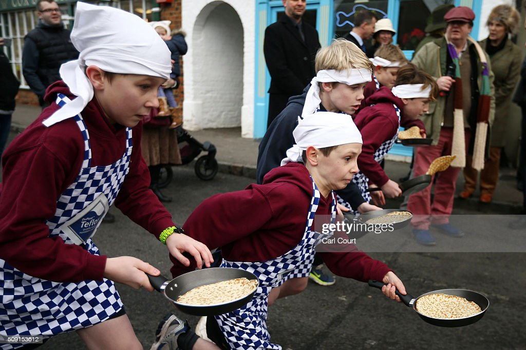 Schoolchildren take part in a pancake race on February 9, 2016 in Olney, England. On Shrove Tuesday every year the ladies of Olney, Buckinghamshire compete in a Pancake Race, a tradition which dates back to 1445. Children from Olney schools also take part in their own races. Olney competes every year against the women of Liberal, Kansas, USA in a friendly race dating back to 1950.