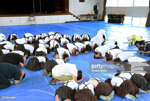 Schoolchildren take part in an evacuation drill in Saijo Ehime Prefecture in southwestern Japan on July 10 in the wake of North Korea's repeated...