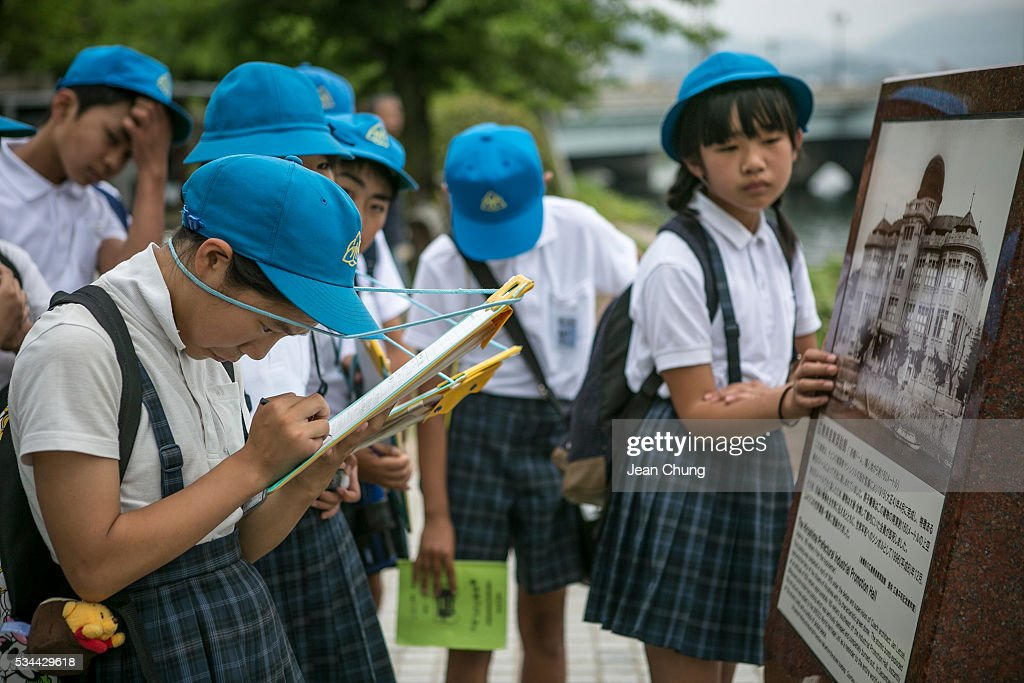 Schoolchildren write down what the guide says at the site of the Atomic Bomb Dome on May 26, 2016 in Hiroshima, Japan. On May 27, President Barack Obama is scheduled to visit Hiroshima, which will be the first time a U.S. president makes an official visit to the site where an atomic bomb was dropped at the end of World War II.