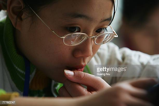 A schoolgirl from the mountain regions studies at an experimental school on November 7 2007 in Chengdu capital of Southwest China's Sichuan Province...