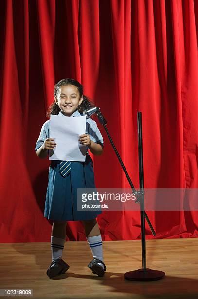 Schoolgirl giving speech on a stage