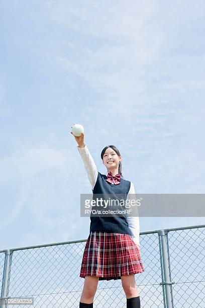 Schoolgirl Holding Softball