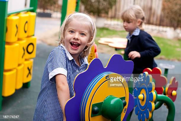 Schoolgirl in Playground in school uniform