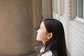 schoolgirl looking up to the sky