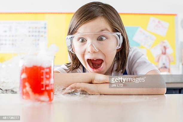 Schoolgirl ( 11-13) oing science experiment