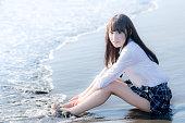 Female senior high school student on a beach