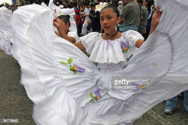 A schoolgirl performs in a parade to commemorate the 186th anniversary of Costa Rica's independence from Spain in San Jose on September 15th 2007 AFP...