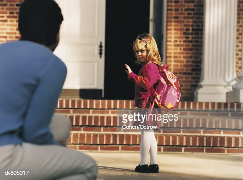 Schoolgirl Saying Goodbye to Mother on her First Day at School