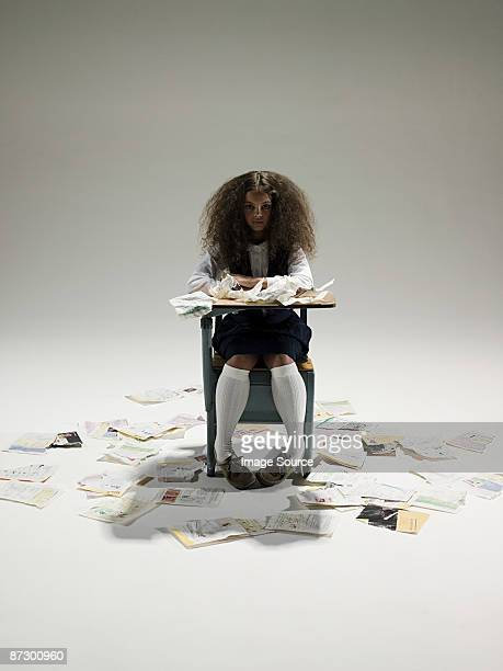 Schoolgirl surrounded by pages