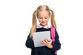 schoolgirl using digital tablet isolated on white