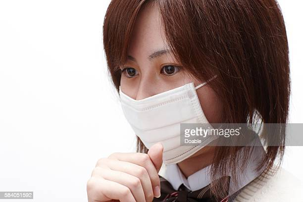Schoolgirl wearing a surgical mask