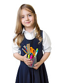 Caucasian child girl with school supplies stationary isolated on white background.