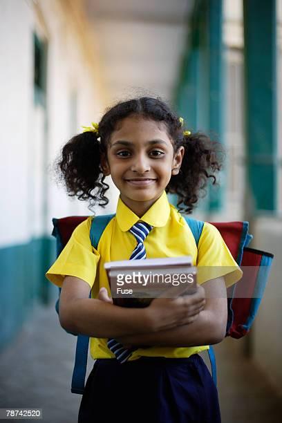Schoolgirl with Textbooks