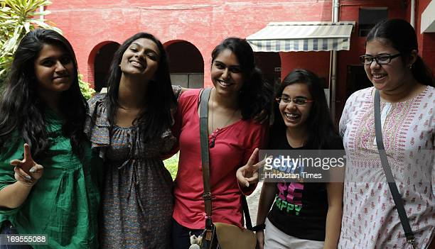 Schoolgirls celebrate their success in CBSE XII Examinations after the declaration of results on May 27 2013 in New Delhi India 8210 per cent...