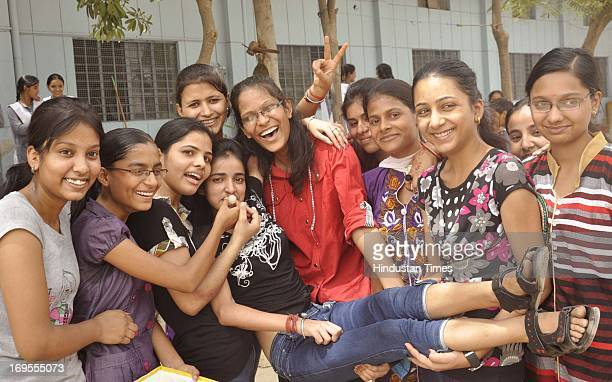Schoolgirls celebrate their success in in CBSE XII Examinations after the declaration of results on May 27 2013 in Ghaziabad India 8210 per cent...