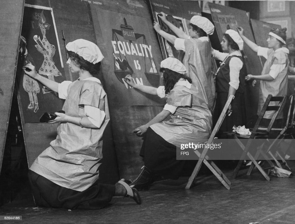 Schoolgirls design posters with women's equality themes as they compete for a prize in a suffrage poster contest at the Fine Arts Club, October 14, 1915.