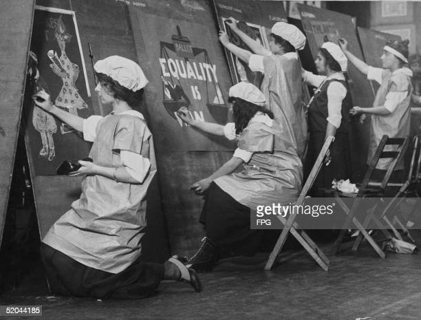 Schoolgirls design posters with women's equality themes as they compete for a prize in a suffrage poster contest at the Fine Arts Club October 14 1915