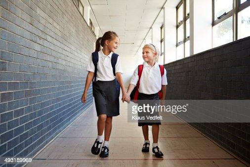 Schoolgirls holding hands in the corridor