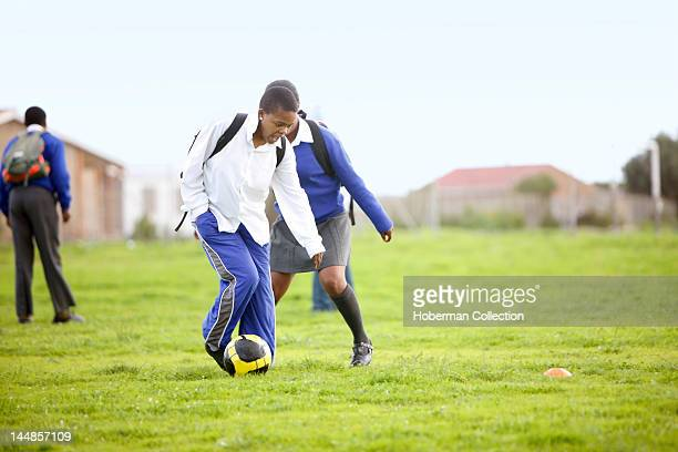 Schoolgirls playing with soccer ball