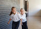 Schoolgirls running &  having fun in a corridor