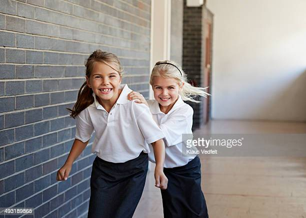 Schoolgirls running &  having fun in a corridor