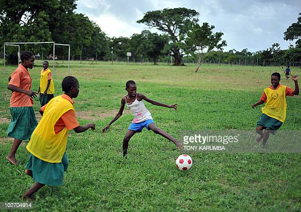 Schoolgirls take part in a football match at Kilifi approximately 50 kilometres northeast of Mombasa on June 23 2010 where an initiative called...