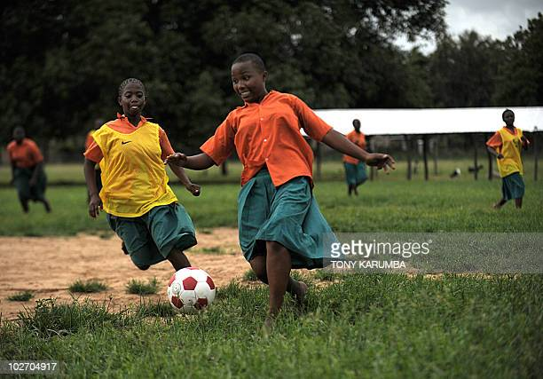 Schoolgirls take part in a football match training session at Kilifi approximately 50 kilometres northeast of Mombasa on June 23 2010 where an...