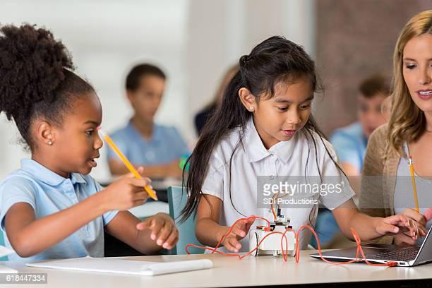 STEM schoolgirls test robotics project in class