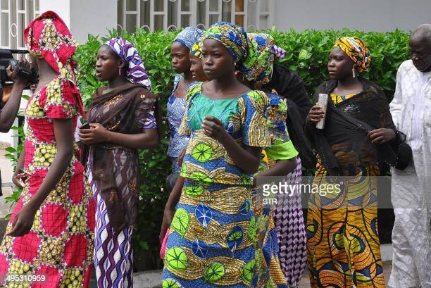 Schoolgirls who have escaped from Boko Haram kidnappers in the village of Chibok arrive at the Government house to speak with State Governor Kashim...