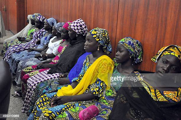 Schoolgirls who have escaped from Boko Haram kidnappers in the village of Chibok sit at the Government house to speak with State Governor Kashim...