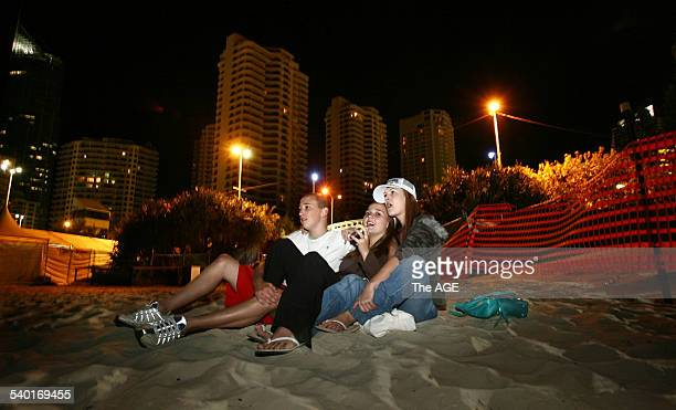 Schoolies Jared Thurkle Kirsty Pepper and Kali Lomman from Lismore on the beach at Surfers Paradise Queensland at midnight kicking off their...