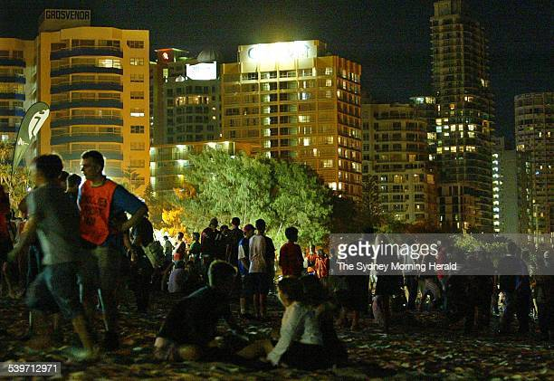 Schoolies on Main Beach during the annual end of year party in Surfers Paradise Queensland against a backdrop of high rise apartments 27 November...