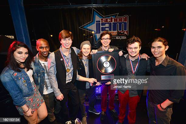 SchoolJam USA cohosts Fivel Stewart Scott Evans and Booboo Stewart pose with newly crowned Best Teen Band in the USA Ergo We Play at NAMM's SchoolJam...