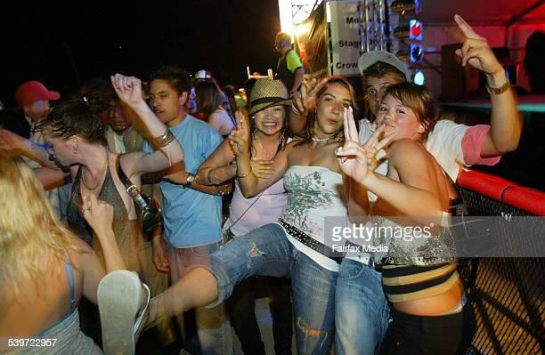 Schoolleavers dance as Schoolies Week on the begins on the Gold Coast 19 November 2005 SHD Picture by PAUL HARRIS
