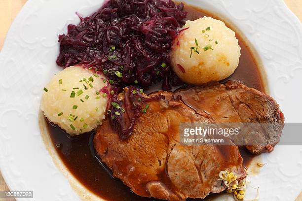 Schweinsbraten, roast pork with dumplings and red cabbage, Upper Bavaria, Bavaria, Germany, Europe