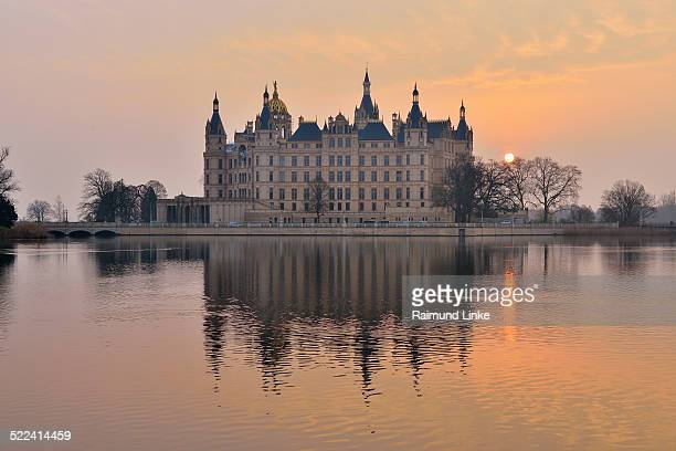 Schwerin Castle reflected in Lake at Sunrise