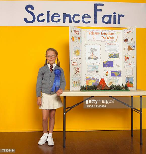 Science fair winner with model volcano