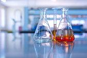 science laboratory glassware orange solution