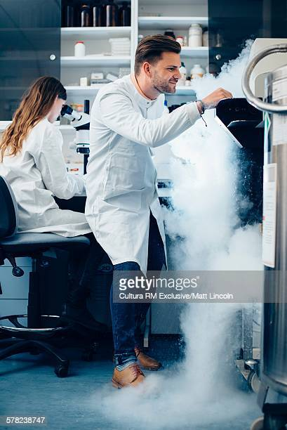 Science student experimenting with liquid nitrogen in laboratory