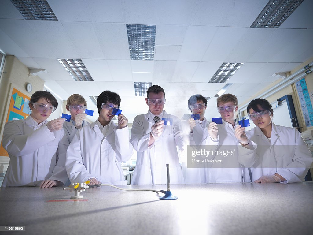 Science teacher and students lighting magnesium in school laboratory  Stock Photo & Science Teacher And Students Lighting Magnesium In School ... azcodes.com